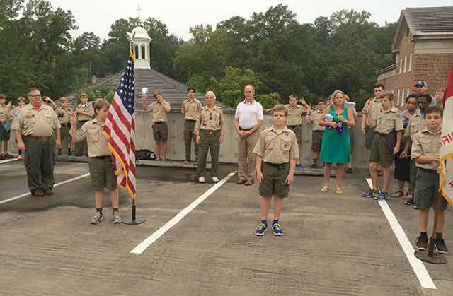 Vulcan DE Michael Wells and the color guard start off the event with the pledge and scout oath and law.
