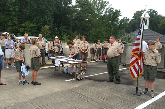 Katy Anderson calls out the Merit Badge leaders and scouts and sends them on their way to the first session.